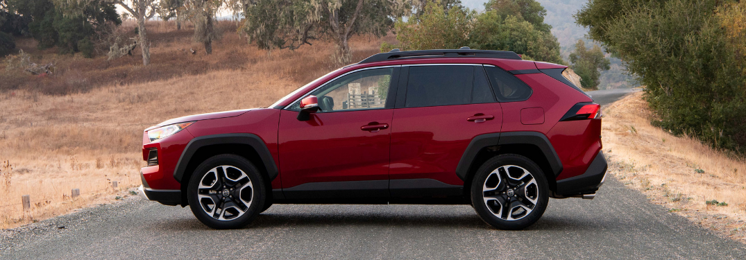 side view of red 2019 toyota rav4