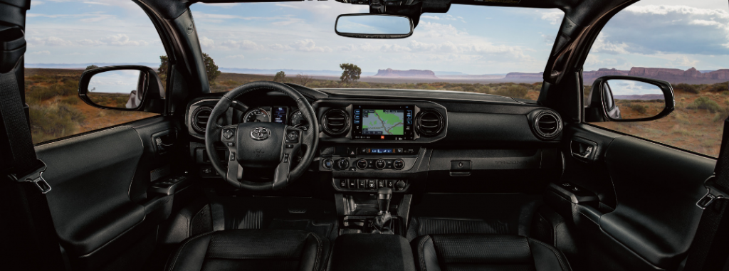 front interior of 2019 toyota tacoma including steering wheel and infotainment system