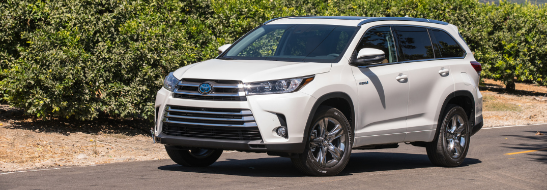 front and side view of white 2019 toyota highlander hybrid