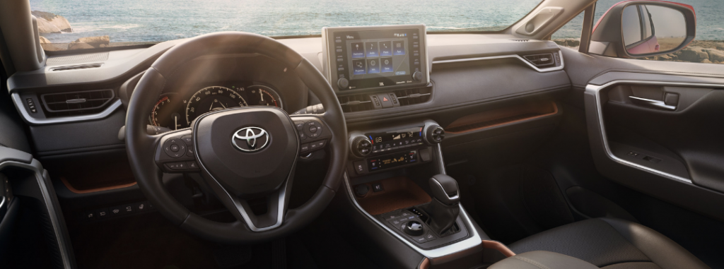 front interior dashboard of 2019 toyota rav4 including steering wheel and infotainment system