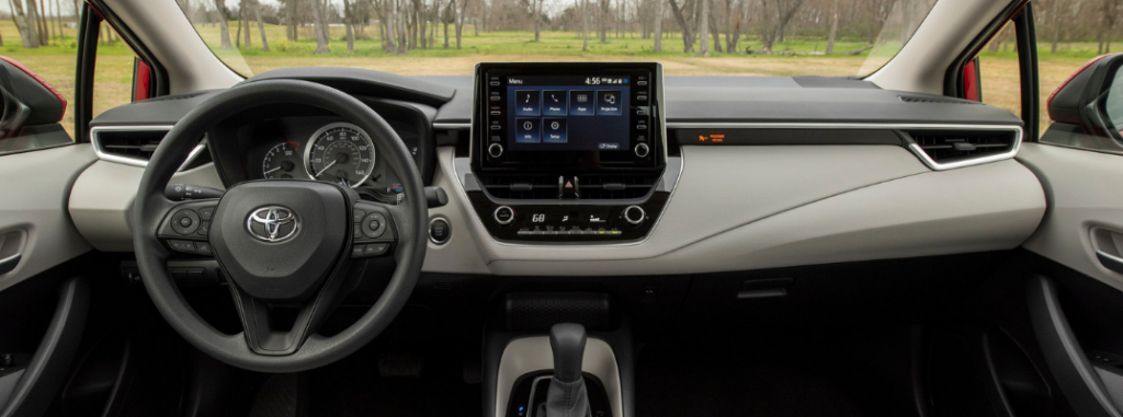front interior of 2020 toyota corolla including steering wheel and infotainment system