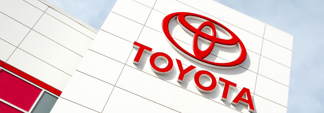 angle view of toyota dealership building and logo