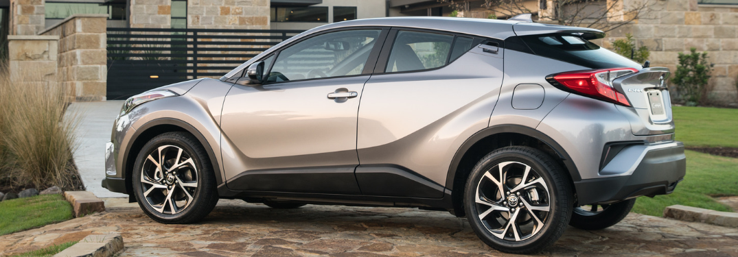 rear and side view of silver 2019 toyota c-hr