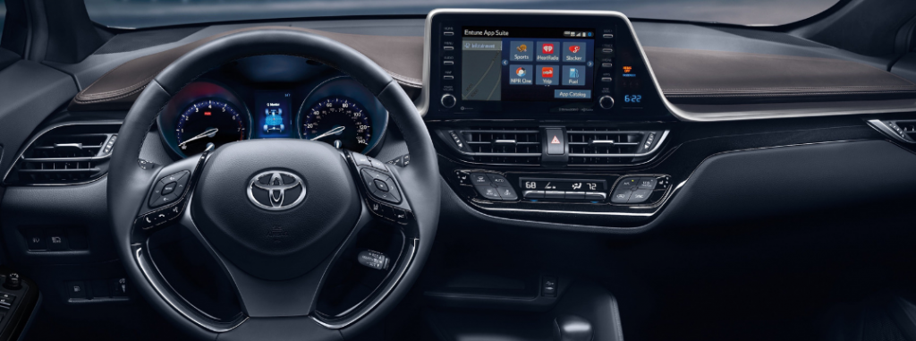 front interior of 2019 toyota c-hr including steering wheel and infotainment system
