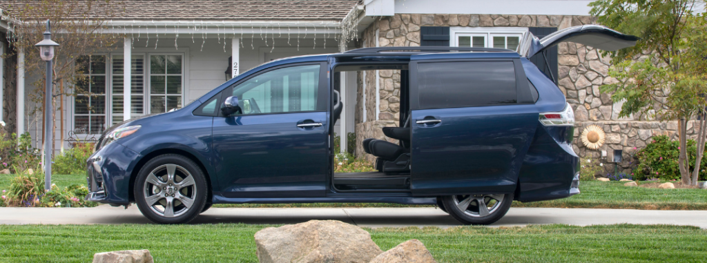 side view of blue 2019 toyota sienna with doors and liftgate open