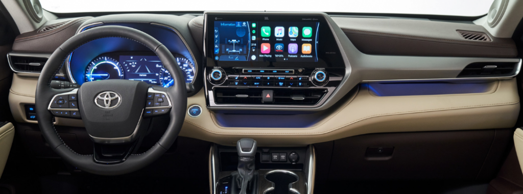front interior of 2020 toyota highlander including steering wheel and infotainment system
