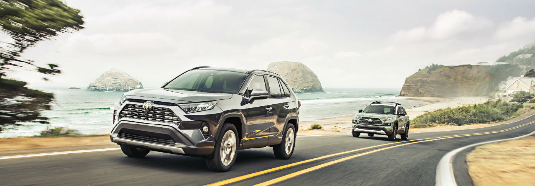 Two 2019 Toyota RAV4 crossover SUVs driving on a road