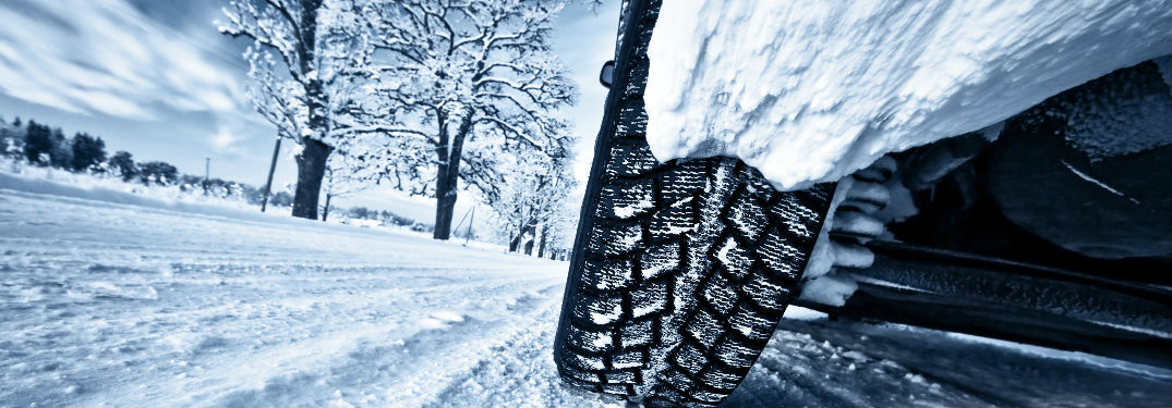 View of tire on a snowy road