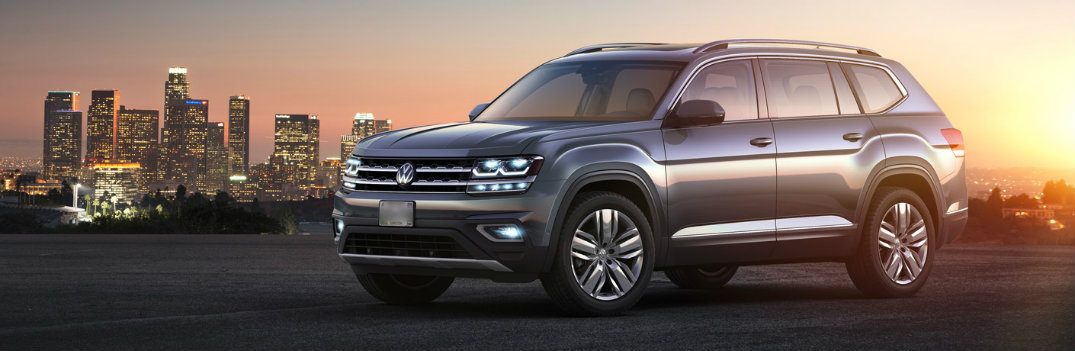 2018 Volkswagen Atlas parked outside a city at sunset
