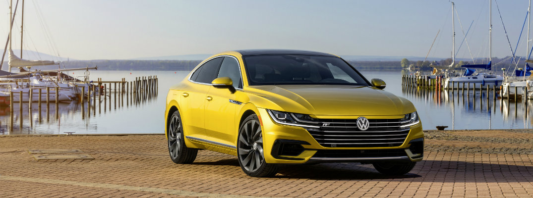 2019 Volkswagen Arteon R-Line Appearance Package gold paint parked on tiled fishing pier beach
