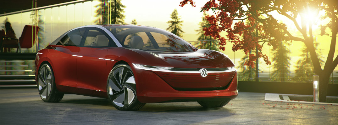 volkswagen i.d. vizzion concept all-electric parked outside luxury forest house at sunset
