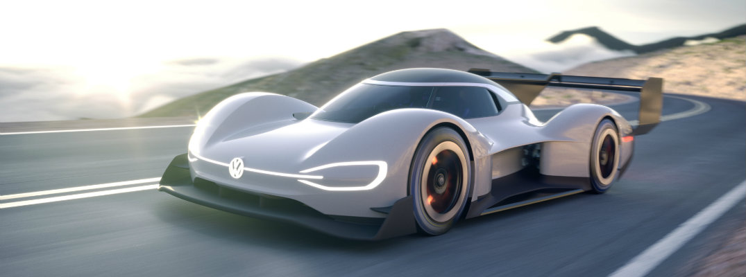 Volkswagen I.D R Pikes Peak concept electric racing car exterior shot speeding down highway