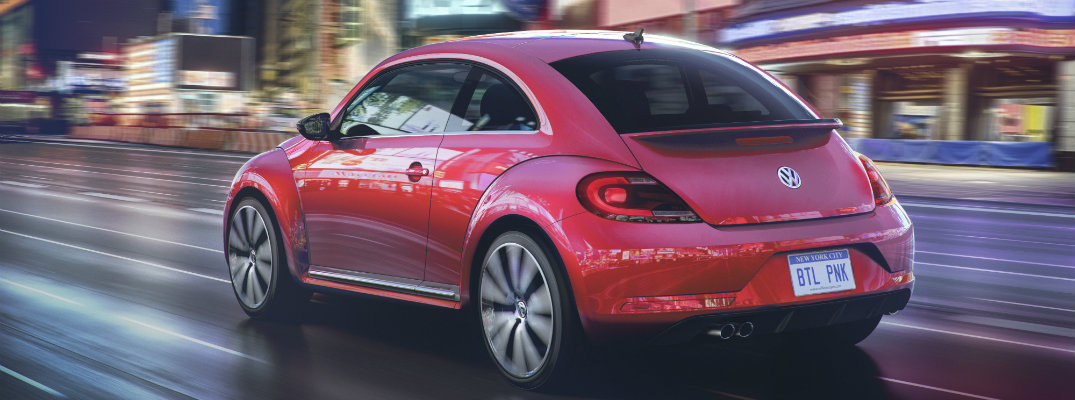 vw beetle exterior in fresh fuchsia metallic paint color