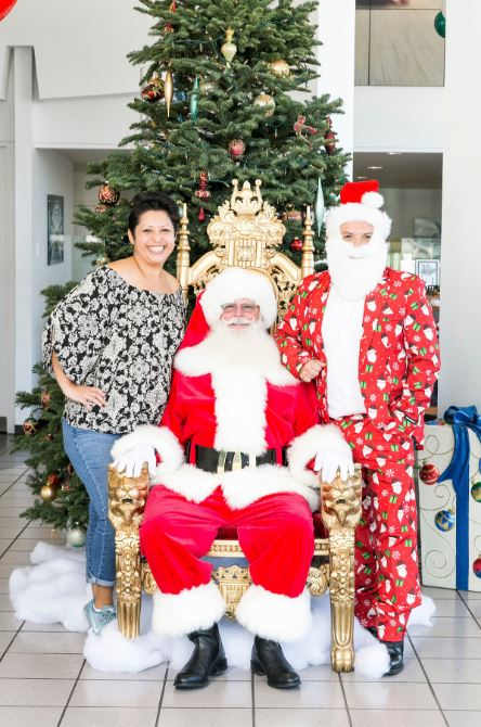 Santa with Festively Dressed Man and Woman