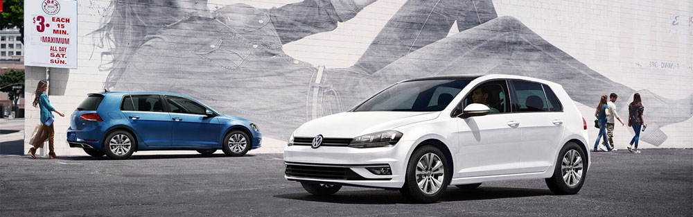 2018 Volkswagen Golf driving by Mural