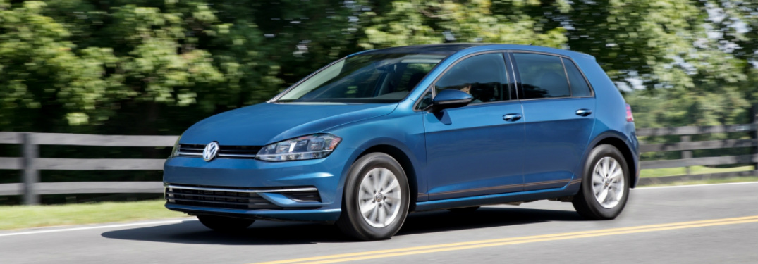 Blue 2018 Volkswagen Golf Driving on a Country Road