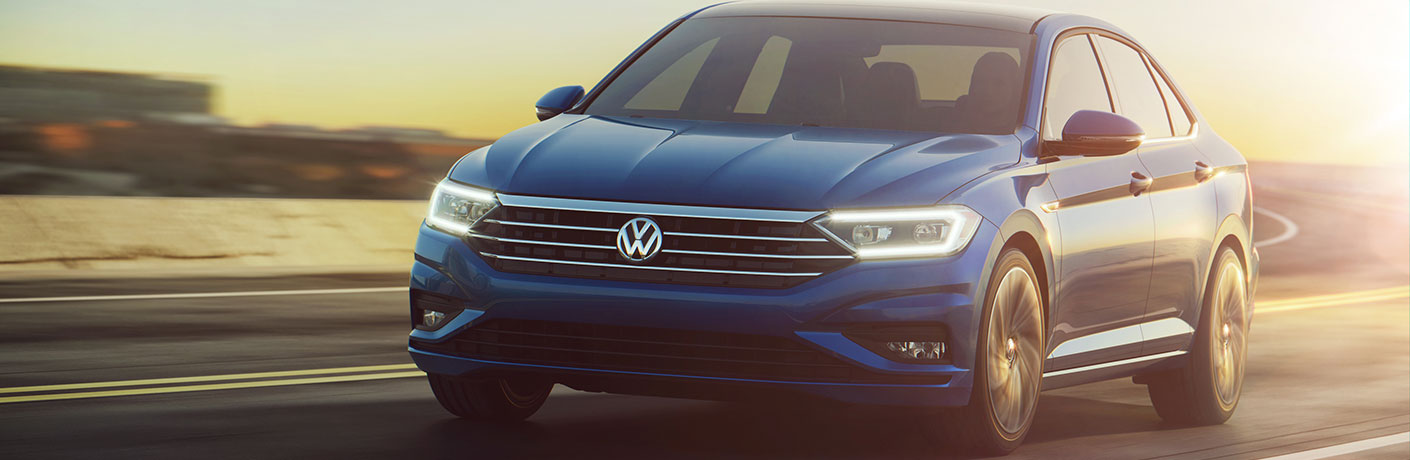 Blue 2019 VW Jetta with the Sunset in the Background