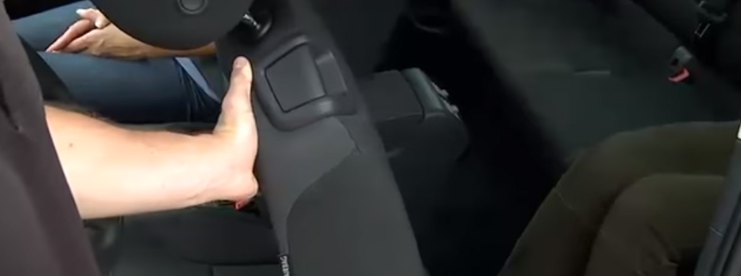 A man operating the Easy Entry Seat in the 2018 VW Golf