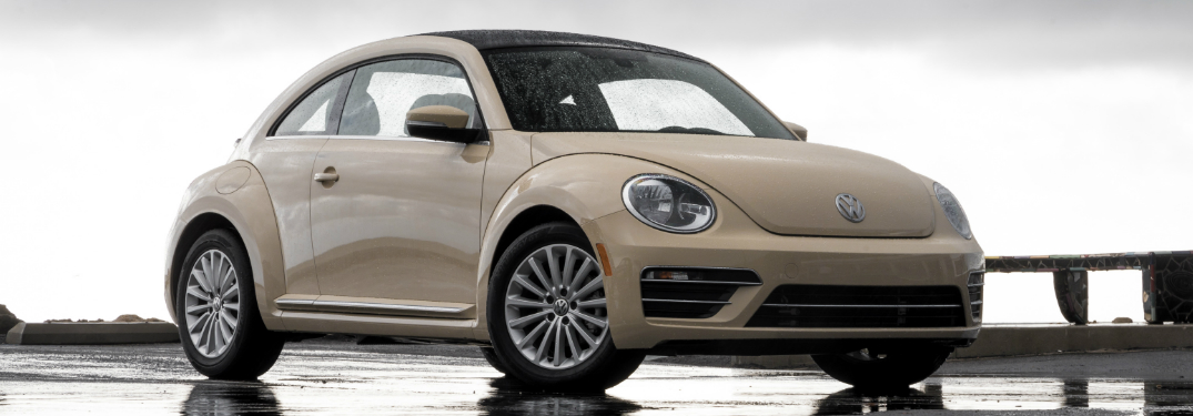 Side view of cream-colored 2019 Volkswagen Beetle