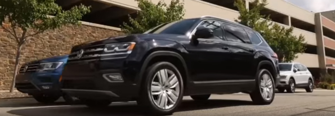 A black Volkswagen Tiguan parallel parking
