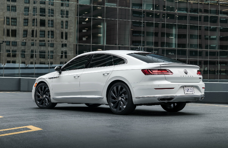 White 2019 Volkswagen Arteon with skyscrapers in the background