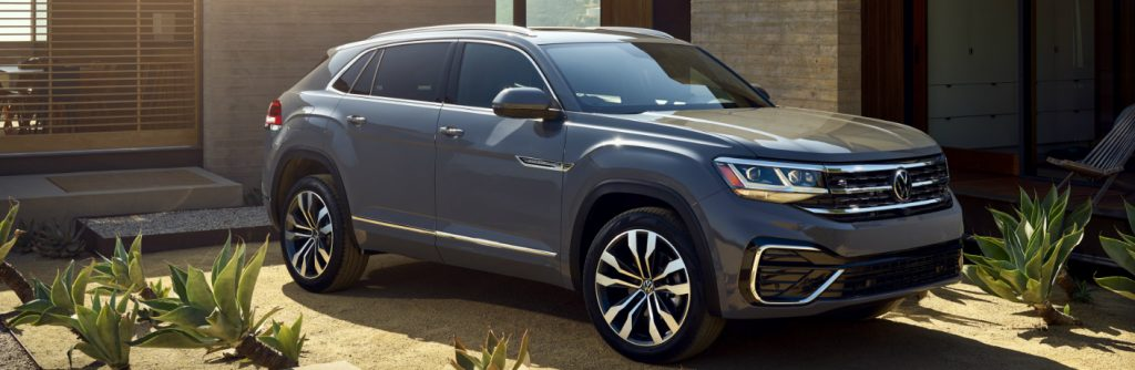 Grey 2020 Volkswagen Atlas Cross Sport parked in front of a house