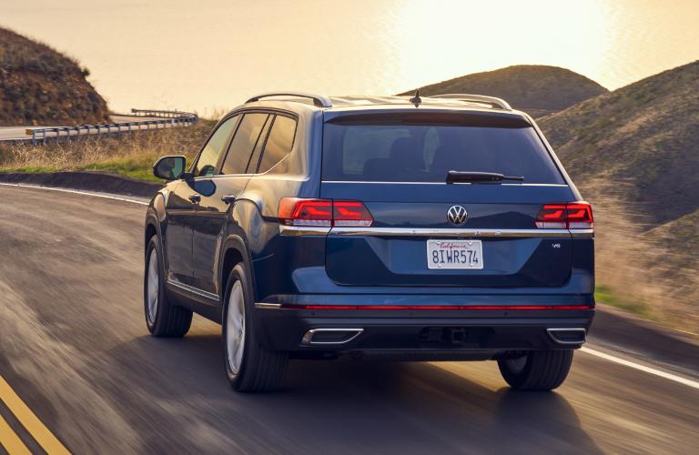 Blue 2021 Volkswagen Atlas driving on a coastal road