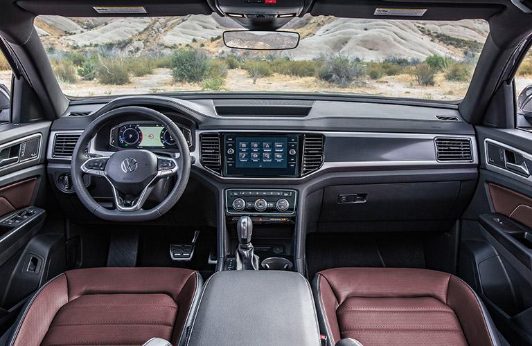 Grey dashboard and maroon front seats in 2020 Volkswagen Atlas Cross Sport