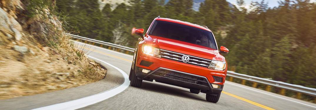 Orange 2020 Volkswagen Tiguan Driving on a Curvy Mountain Road