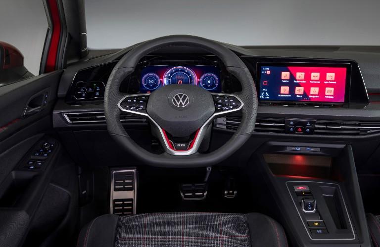 Steering wheel, gauges, and touchscreen in 2022 Volkswagen Golf GTI