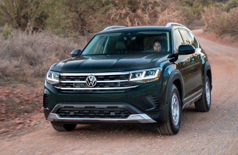 Driver's side front angle view of green Volkswagen Atlas with Basecamp accessory line