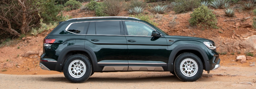 Side view of green Volkswagen Atlas with Basecamp accessory line