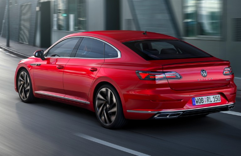 Driver's side rear angle view of red 2021 Volkswagen Arteon