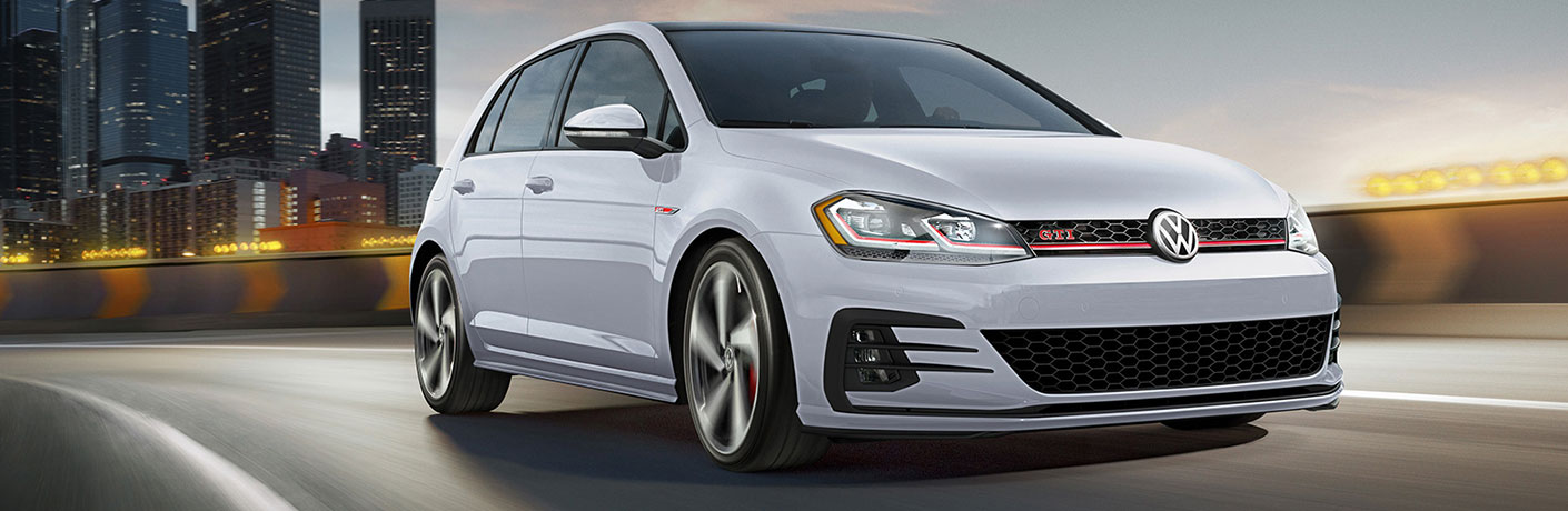 Passenger's side front angle view of white 2020 Volkswagen Golf GTI
