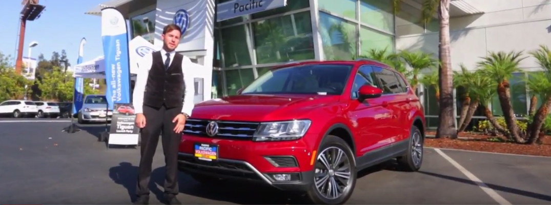 Man at Pacific Volkswagen Standing next to a Red 2018 VW Tiguan