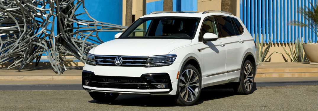 White 2018 VW Tiguan with R-Line Appearance Package Parked Next to a Metal Sculpture