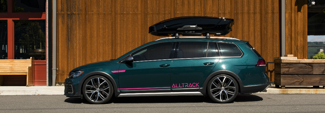Side view of blue-green 2019 Volkswagen Golf Alltrack Combi Concept with a cargo box on the roof
