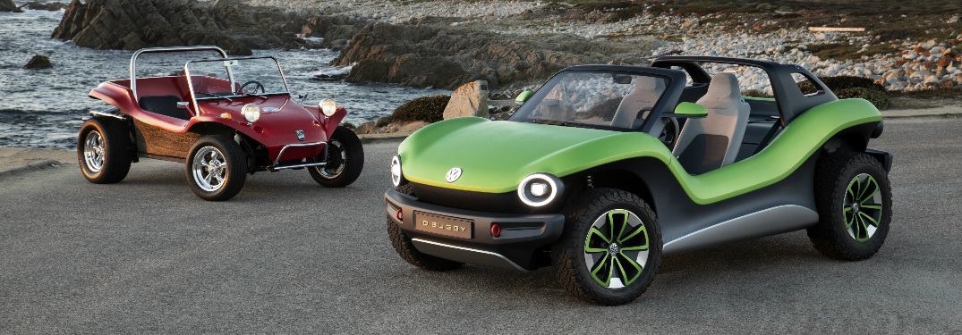 Green Volkswagen ID. Buggy Concept and a classic red California dune buggy parked near the ocean