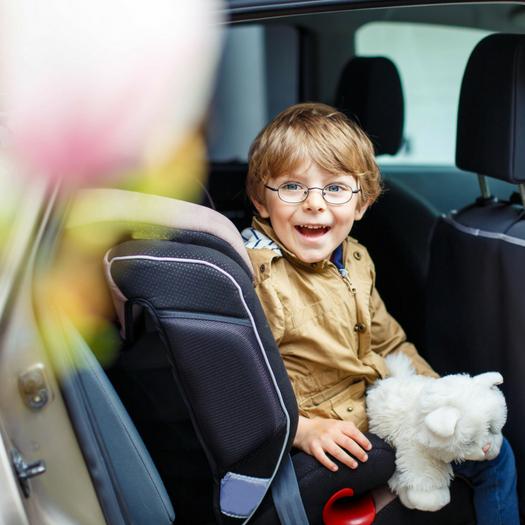 Little Boy In Backseat