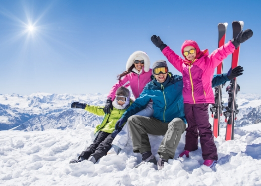 family of skiers on hill