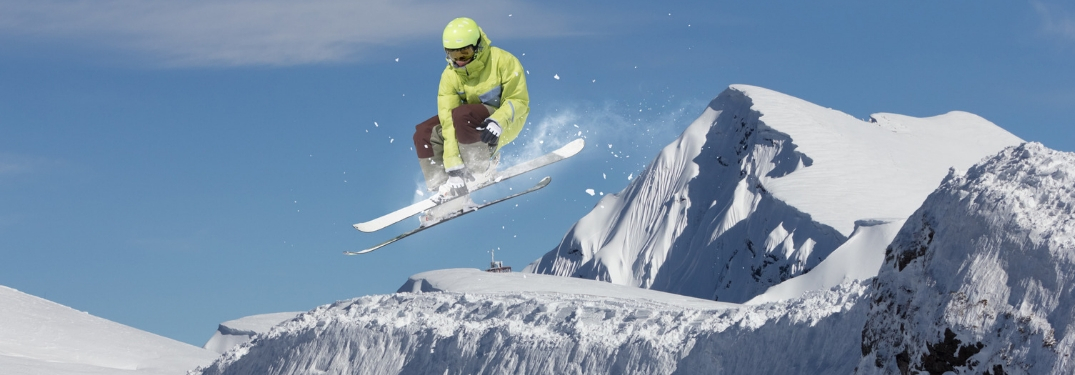 snowboarder jumping in front of mountain
