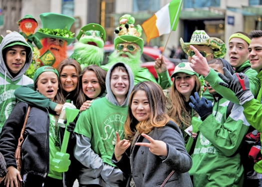 group of people wearing green and celebrating st pats