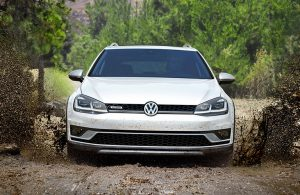 2019 Volkswagen Alltrack driving on a muddy road