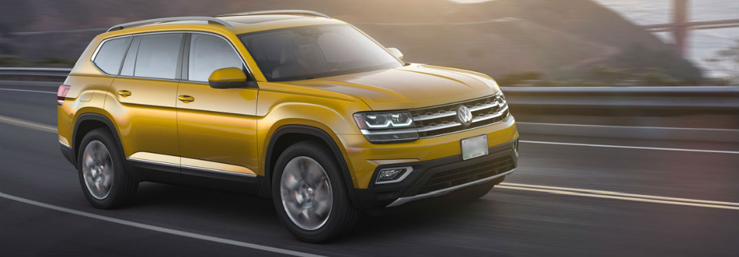 Side profile of the 2018 Volkswagen Atlas driving down highway
