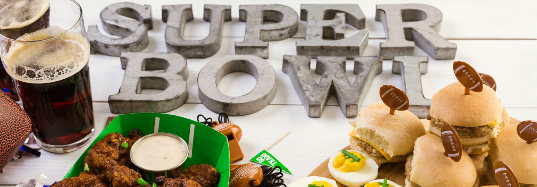 Supper bowl spelled out with beer and snacks around the lettering