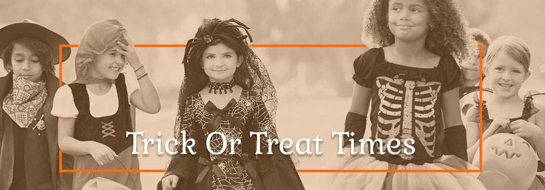 Trick-or-treat text with children in costumes in the background