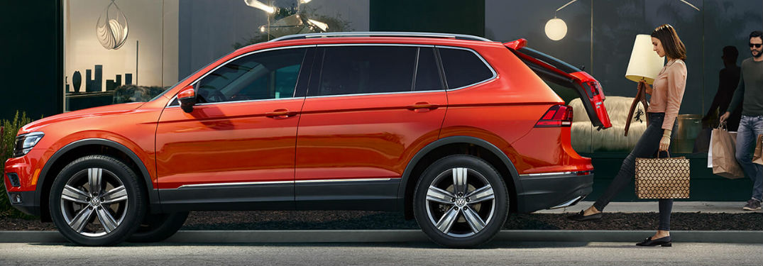 Woman opening the rear lift gate of a 2019 Volkswagen Tiguan