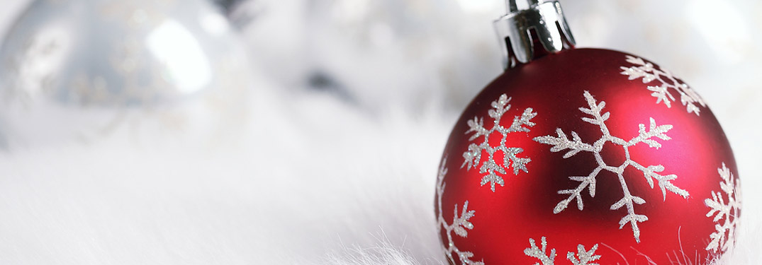 Red Christmas Ornament on a White Background