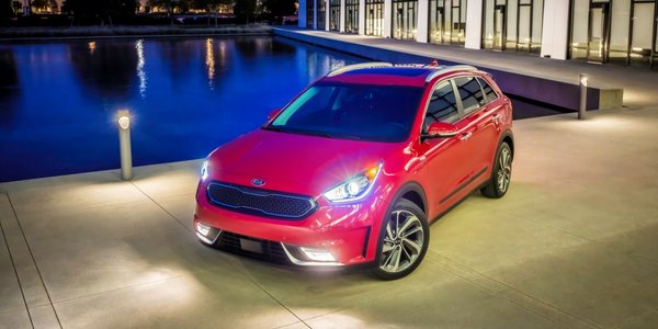 2018 Kia Niro Front View Of Red Exterior With Headlights On O