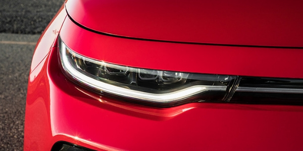 2020 Kia Soul Close-up of Headlight with Red Exterior